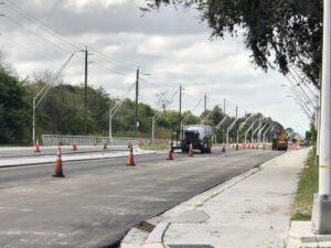 Workers paving new asphalt on 45th Street East