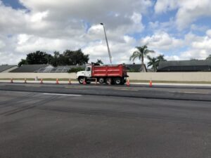 Dump truck full of asphalt for resurfacing of 45th Street East