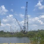 A view of bridge construction from the western riverbank