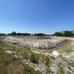 Continued progress of the stormwater retention pond near Caruso Road and 44th Avenue East